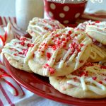These Peppermint Crunch Sugar Cookies are perfect for the holidays! Buttery, soft, tender sugar cookies flavored with crunchy peppermint chips, creamy white chocolate, and candy cane sprinkles! Crunchy, fluffy, minty goodness!