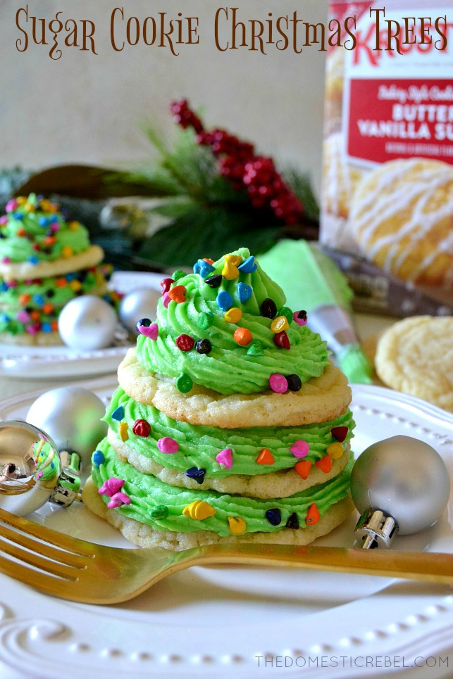 three sugar cookies stacked with green icing and rainbow sprinkles to look like a christmas tree