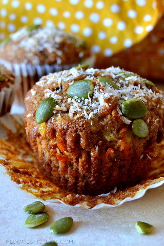 These Morning Glory Muffins are healthy, easy and PACKED with flavor! They taste like carrot cake and are bursting with flavor from pineapple, coconut, apples, pepita seeds, flavorful spices and a healthy boost from whole wheat flour and ground flax!