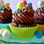 These Chocolate Malt Cupcakes are so fun, easy, and fabulous! Fudgy, moist chocolate buttermilk cake topped with a mountain of chocolate malt frosting and malted milk eggs. Perfect for springtime!