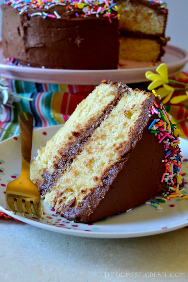 This is the BEST Yellow Cake with Fudge Frosting! Supremely moist, homemade and EASY buttery yellow cake layers with a creamy, luscious chocolate fudge frosting. Perfect for any occasion, and a real crowd-pleaser!