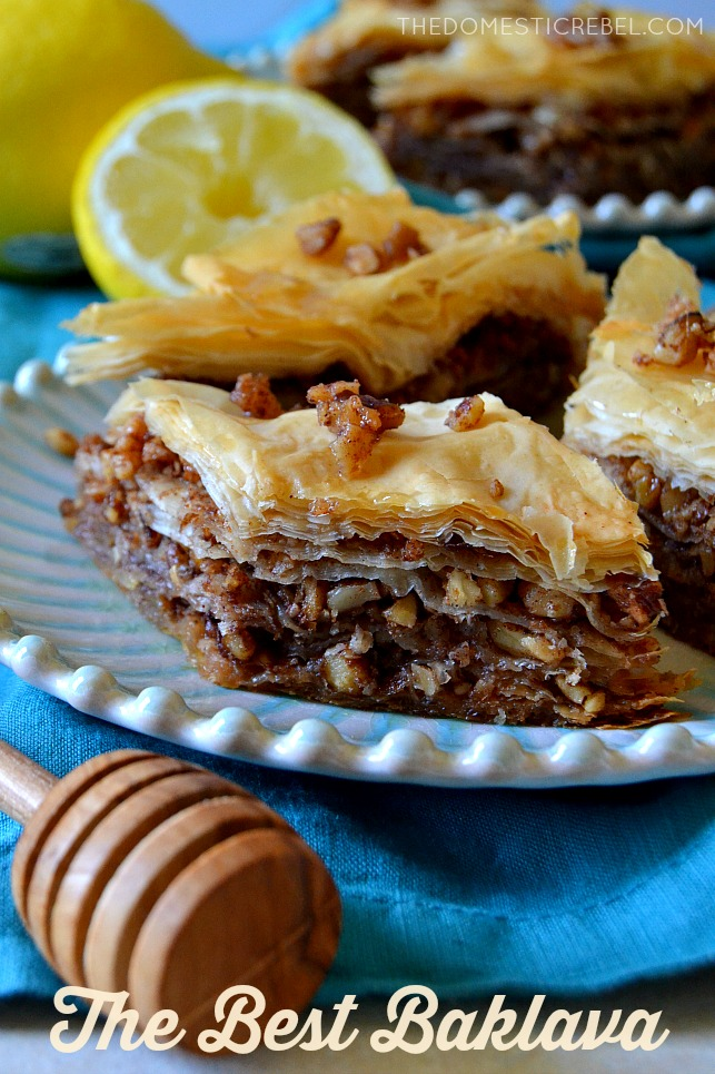 three pieces of baklava on a blue plate
