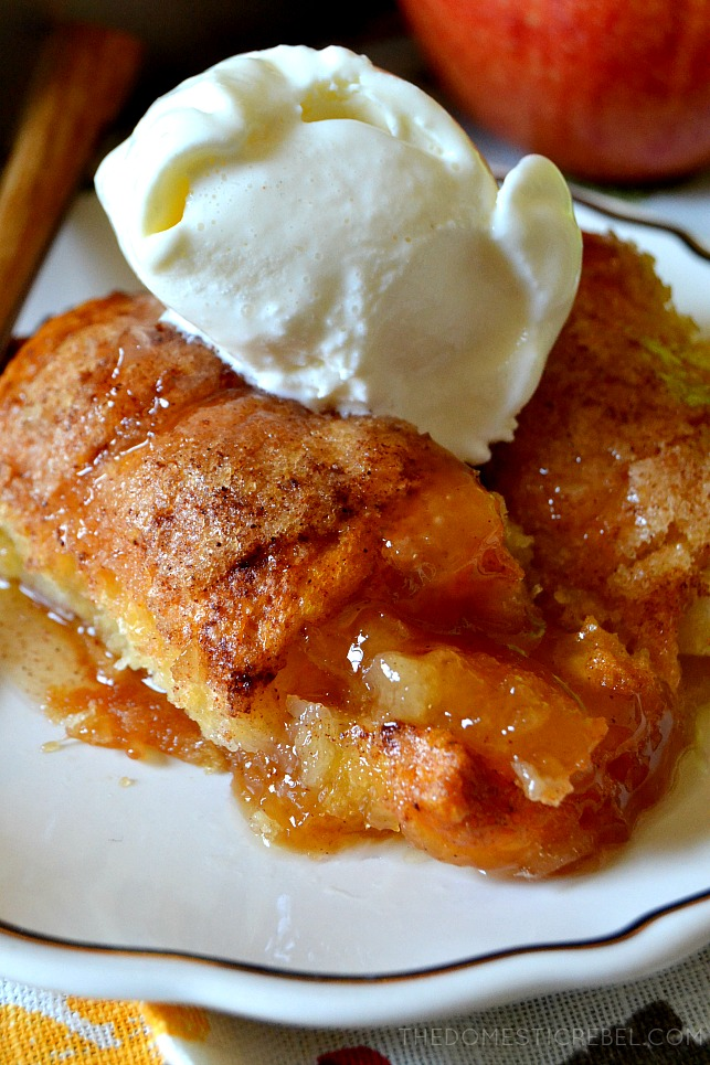 Close up of two apple dumplings topped with vanilla ice cream