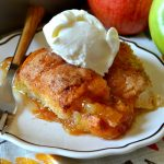 These Quick & Easy Apple Dumplings couldn't be simpler! Juicy Granny Smith apples are transformed into tender, saucy apple dumplings topped with an amazing butter sauce and a caramelized, crackly sugar topping. A perfect dessert that will please a crowd!
