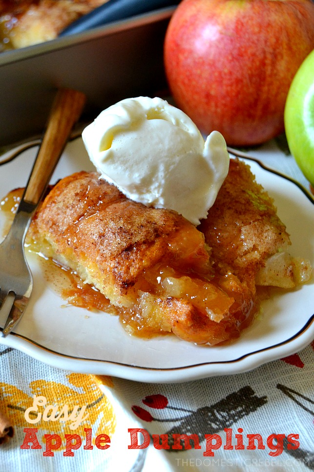 Photo of apple dumplings on a white plate topped with vanilla ice cream.
