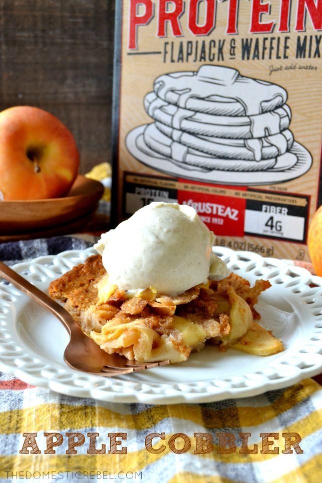 A piece of apple cobbler on a plate in front of Krusteaz Protein mix