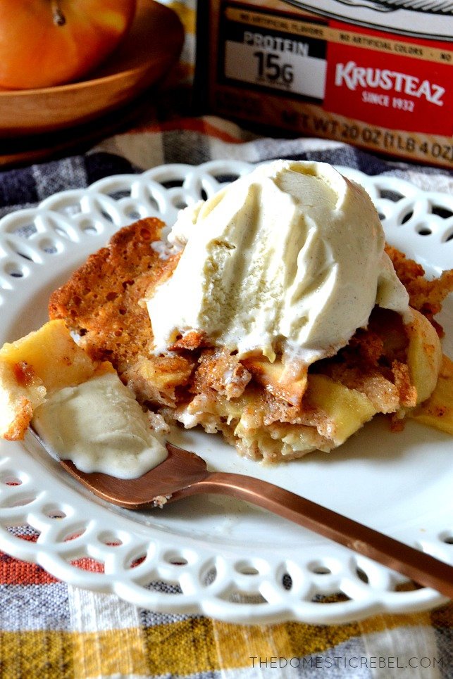 A piece of apple cobbler with a bite on a fork