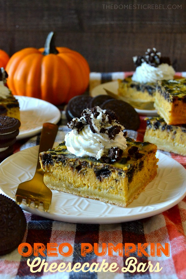 A slice of Oreo pumpkin cheesecake bars on a white plate with a gold fork