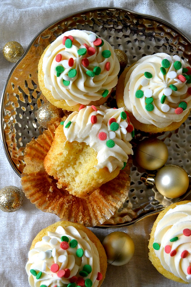 Aerial view of an eggnog cupcake on its side with a bite taken out of it