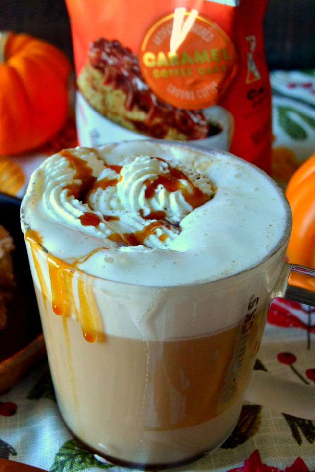 Mug of caramel brulee latte topped with whipped cream and caramel