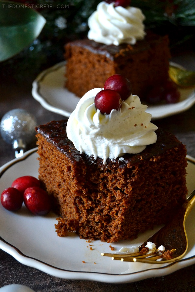 A square of gingerbread cake with a bite-sized piece removed