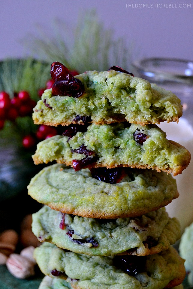 A stack of the cranberry pistachio pudding cookies, with two of them split in half to show the texture