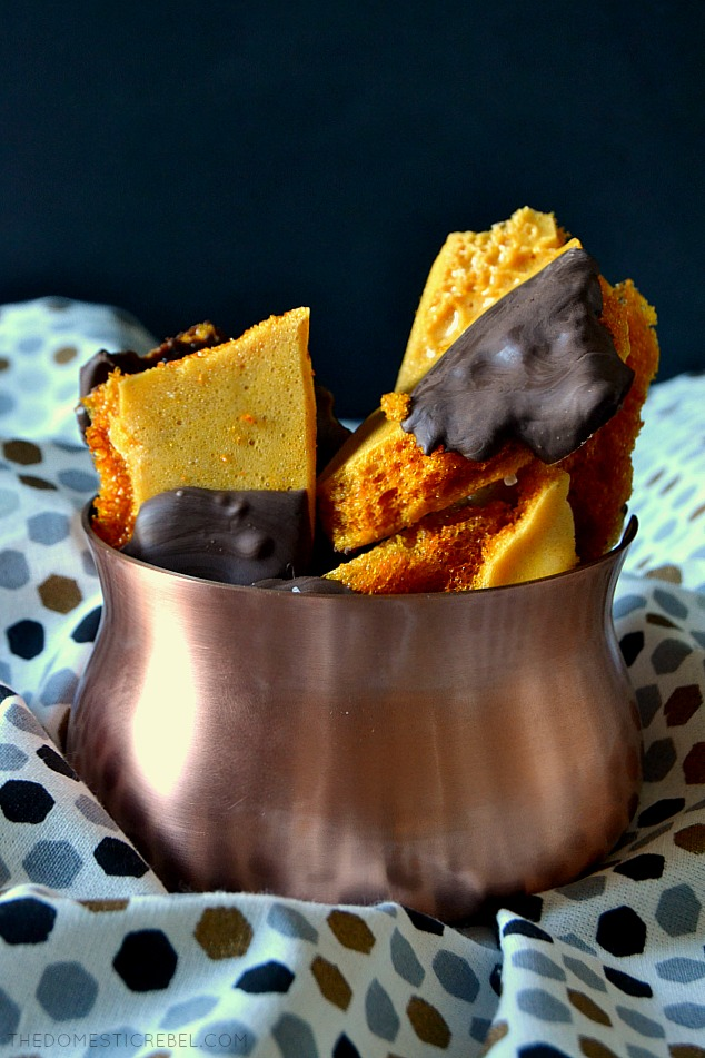 A few pieces of honeycomb sponge candy in a bronze bowl