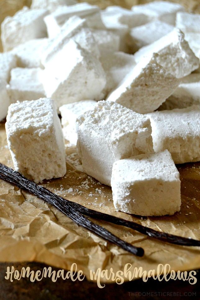 Homemade marshmallows with vanilla bean sticks on brown paper