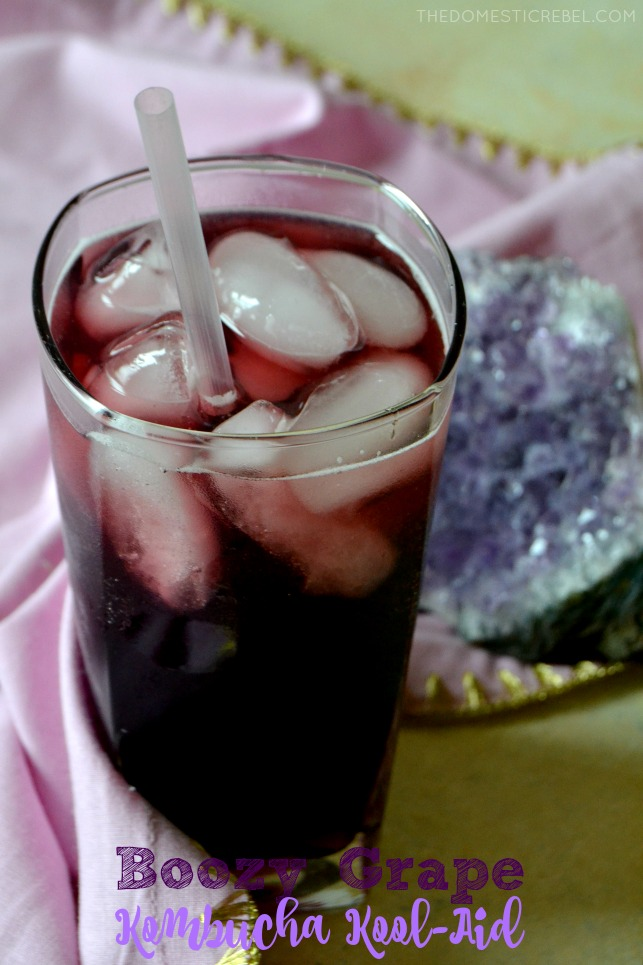 boozy grape kombucha koolaid with straw and crystal