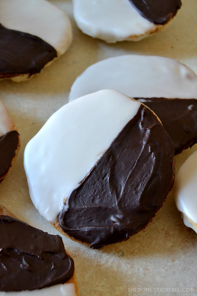 These Best-Ever Black & White Cookies are so fantastic, they taste even BETTER than the ones in NYC delis! Moist, soft and supremely fluffy cake-like vanilla cookies frosted with a two-toned icing, just like in Manhattan.