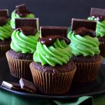 Andes Mint Cupcakes are easy, decadent, delectable moist fudge cupcakes topped with a sweet mint buttercream and rich chocolate ganache! Simple, perfect, and flavorful, they're the perfect homage to the after dinner mint everyone loves!