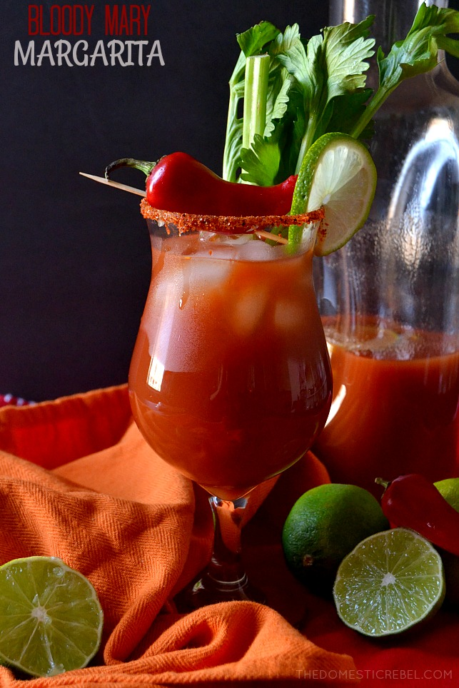 bloody mary margarita with chili pepper, lime wedges, celery