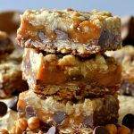 These are the BEST ever Carmelitas! Buttery oatmeal cookie dough layers sandwiching gooey, buttery caramel and rich chocolate chips in every bite! Gooey, chewy, sweet and delicious, these bars are amazing!