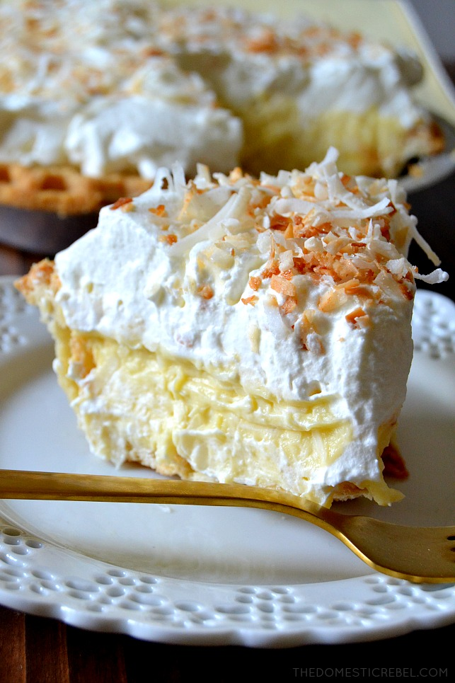 This is the BEST recipe for Homemade Coconut Cream Pie! Silky, decadent, creamy coconut custard in a flaky, buttery pie crust and topped with fresh sweetened whipped cream and toasted nutty coconut. So easy, delectable and makes for an amazing party dessert!
