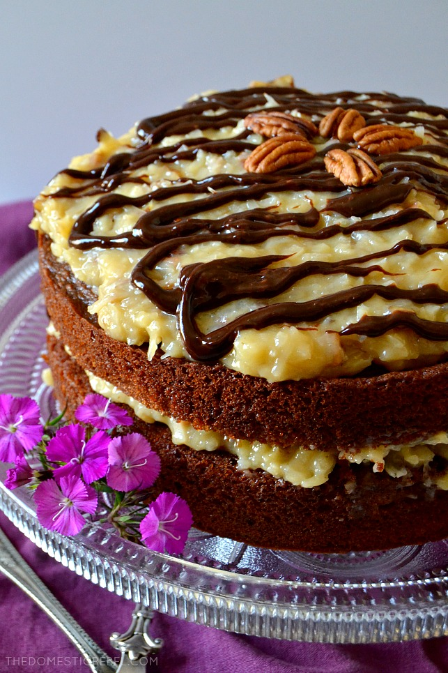 This is the most amazing German Chocolate Cake recipe! Moist, tender chocolate cake surrounded by scratch-made, buttery coconut pecan frosting! Rich and decadent yet simple, this cake needs to make it into your recipe box!