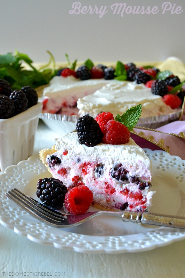 no-bake berry mousse pie on white plate with pie in background and fresh berries