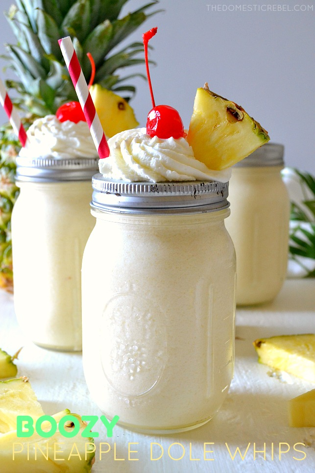 boozy dole whips in jars with pineapple wedges