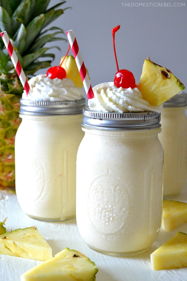 These Boozy Pineapple Dole Whips are an adult take on a Disneyland copycat treat! Smooth and creamy with sweet pineapple and vodka swirled throughout! Perfect for a hot summer day or a pool party!