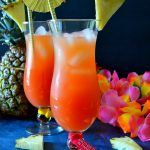 This Caribbean Rum Punch is easy and comes together in literal seconds, and it tastes AMAZING! Made with fruit juices and three kinds of rum, it's perfect for parties because it can be easily doubled or tripled! Refreshing, sweet and totally delicious!