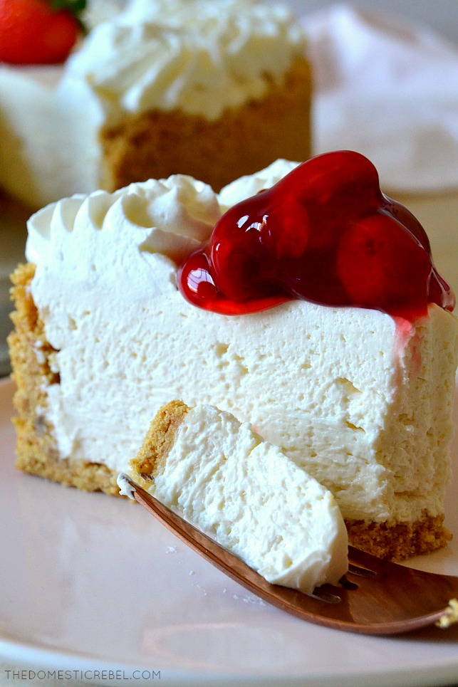 This No-Bake Cheesecake is the BEST EVER! Super rich, smooth, creamy and fluffy, it tastes like authentic New York cheesecake but in a dreamy no-bake version! Comes together pretty quickly, can be made ahead and great for serving a crowd! The perfect no-bake dessert!