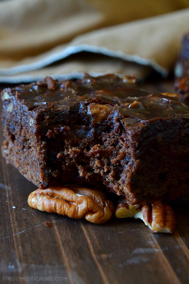 These Beer-Spiked Brownies with Poured Pecan Frosting are to-die for! Rich and fudgy, these chocolaty brownies have a hint of brown ale in every bite with an addictive, melt in your mouth sheetcake-style frosting on top! You will love this recipe!