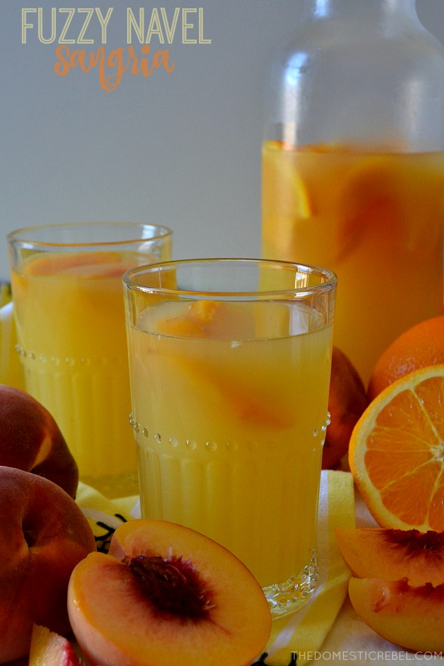 fuzzy navel sangria with pitcher and fresh peaches and oranges