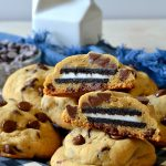These Oreo Stuffed Chocolate Chip Cookies are unique, tasty, and super easy! Everyone will be blown away that these soft and chewy chocolate chip cookies are filled with an Oreo inside!