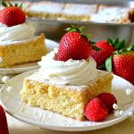 This WHIPPED CREAM CAKE is absolutely delicious, easy, and a great old-fashioned recipe that still holds up today. Moist and fluffy with a light texture similar to Angel food cake, it's made with real, fresh whipped cream swirled in the batter for tremendous flavor!