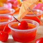 These Tequila Sunrise Jello Shots are the perfect go-to party favor with two layers of delicious tequila-spiked Jello in every cup! These fun, life-of-the-party shots perfectly represent fiery Leos in my Zodiac Cocktail Series!