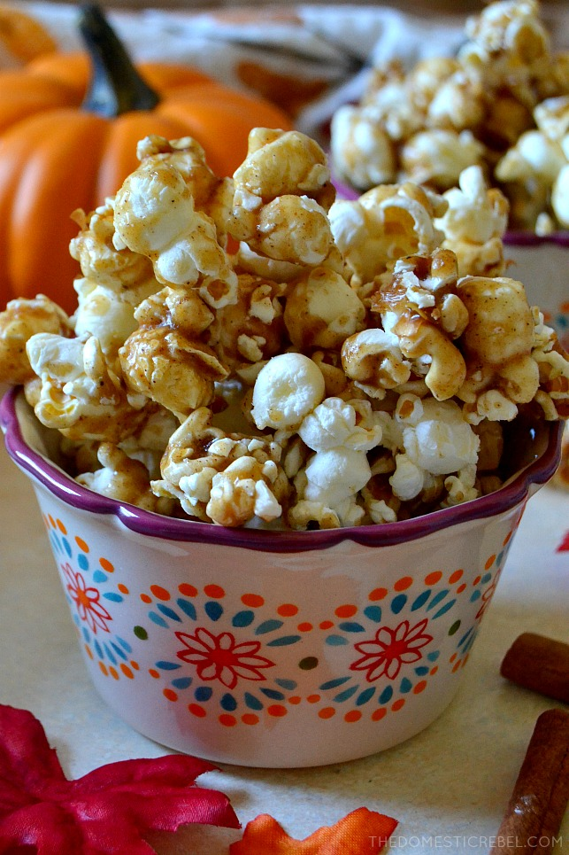 This Pumpkin Spice Caramel Popcorn is an easy, addictive treat everyone will love! Crunchy, crispy, salty popcorn coated in a homemade, gooey & buttery caramel sauce with lots of pumpkin pie spice for a kick! Just try not to eat the whole batch!