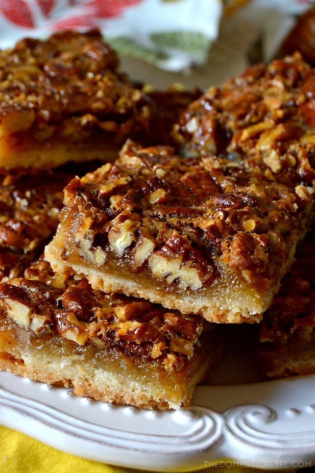 These Super Easy Pecan Pie Bars are going to be your go-to recipe from now on! Perfectly portioned and portable, these chewy and gooey bars have a buttery shortbread crust and the most incredible pecan pie filling!