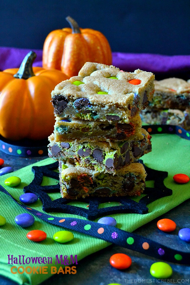 These Halloween M&M Cookie Bars are like deep dish chocolate chip cookies! Soft, chewy, buttery and chocolaty with festive Halloween M&M's candies and lots of flavor! Great for feeding a crowd!
