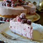 This No-Bake Cranberry Cheesecake is for serious cranberry lovers! Sweet, light and fluffy, it's made with whole berry cranberry sauce for a tasty, tart and tangy cheesecake topped with beautiful sugared cranberries!