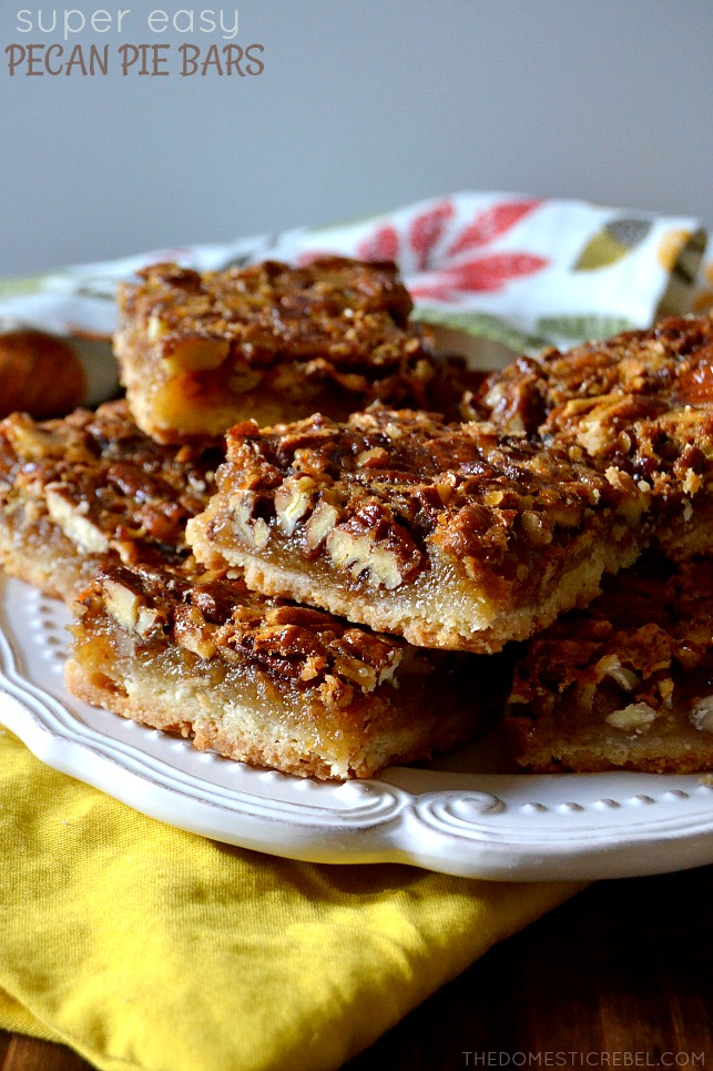pecan pie bars stacked on white plate and yellow cloth