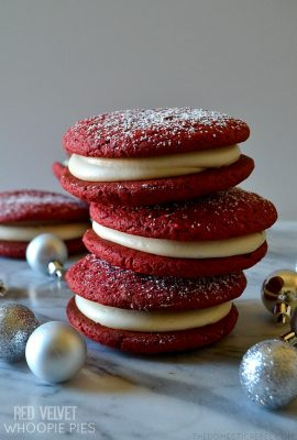 "These Red Velvet Whoopie Pies are a must make any time of year! Pillowy soft and chewy, rich red velvet ""cookies"" sandwiched around sweet and tangy cream cheese frosting for the ultimate Southern-inspired sweet treat!"
