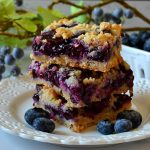 These Blueberry Crumb Bars are the BEST! Super buttery, tender, soft and filled with juicy, gooey fresh blueberry filling! They come together quickly, feed a crowd and are totally easy!