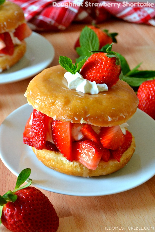 doughnut strawberry shortcake on white plates with strawberries