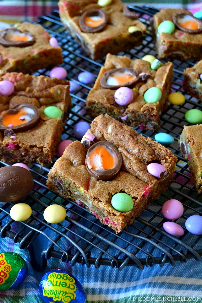 These Cadbury Easter Egg Cookie Bars are soft and chewy chocolate chip cookie bars fully loaded with pastel M&M's and Cadbury creme eggs for a delightful Easter treat!