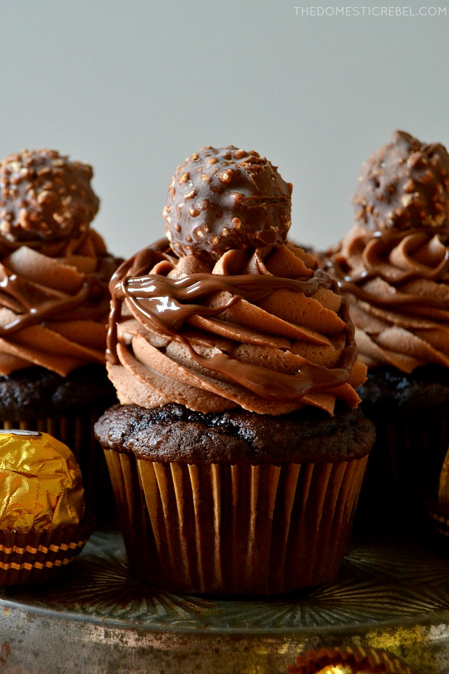 nutella ferrero rocher cupcakes arranged on metal tin with candy