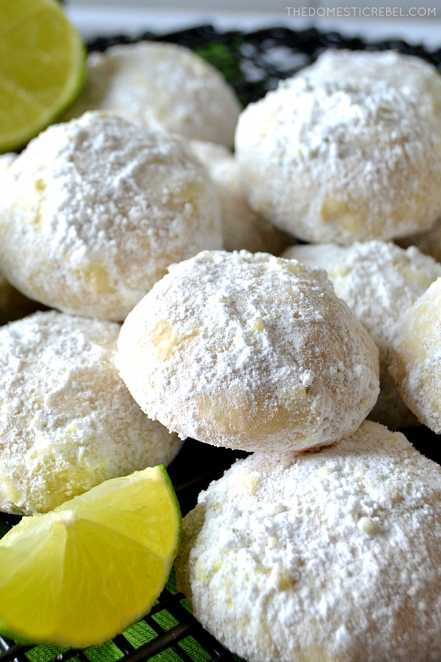 closeup of a pile of key lime cooler cookies with limes