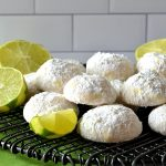 These Key Lime Cooler Snowball Cookies are a fantastic update to a classic Christmastime cookie! Made with real Key lime juice for a sweet and tangy twist on this soft and tender cookie!