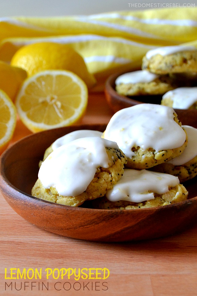 lemon poppyseed muffins on wood plate with lemons