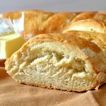 This Perfect & Easy Crusty French Bread is out of this world! Recipe yields two loaves of a buttery, crispy crusted bread with a super soft and fluffy interior. So easy, comes together quickly and tastes amazing using pantry staple ingredients!