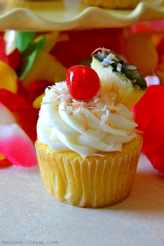 pina colada cupcakes in front of flowers